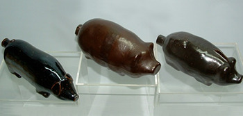 Click photo to see larger pic of Collectible Figural Pig Bottles