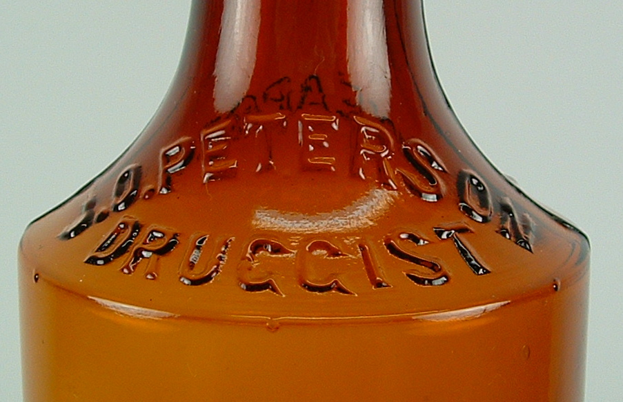 AMBER J.O. PETERSON DRUGSTORE BOTTLES - LOT OF SIX